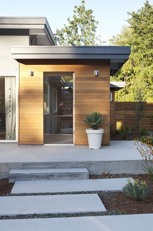 Contemporary Front Door with Pathway, Fence, exterior tile floors, French doors