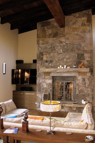 Rustic Living Room with Sierra Foyer Table in Ash, Paint, Exposed beam, picture window, Wall sconce, stone fireplace