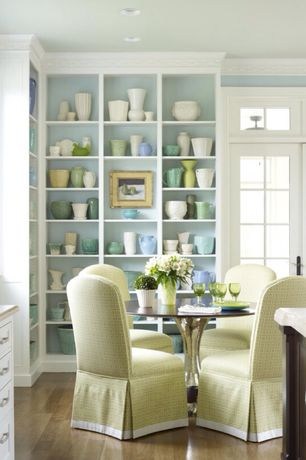 Traditional Dining Room with Crown molding, Pedestal dining table, Paint, Standard height, Built-in bookshelf, Casement