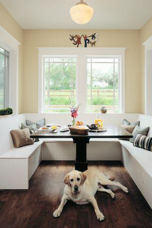 Traditional Dining Room with Window seat, Hardwood floors, flush light