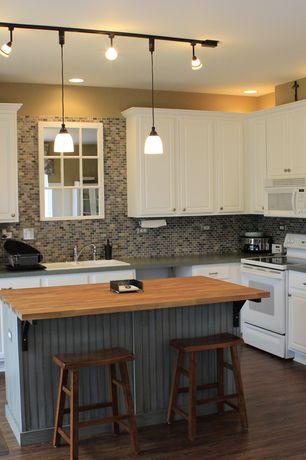 Traditional Kitchen with L-shaped, Hampton Bay Hampton Satin White Cabinets, Slate counters, Breakfast bar, Wood counters