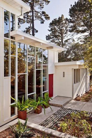 Contemporary Front Door with Fence, six panel door, exterior concrete tile floors, picture window, Pathway