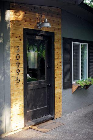 Rustic Front Door with exterior stone floors