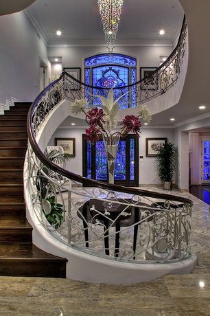 Traditional Staircase with Paint, Balcony, Modern raindrop chandelier, Clear glass vase, curved staircase, High ceiling