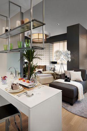 Contemporary Great Room with interior wallpaper, flush light, Hardwood floors