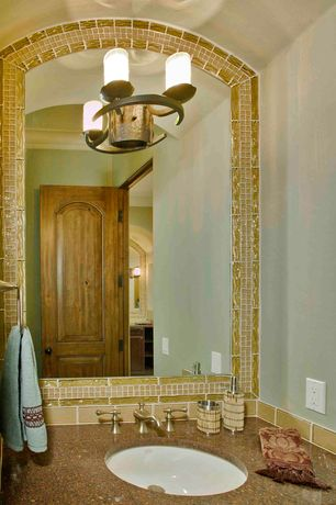 Mediterranean Powder Room with Stone Tile, wall-mounted above mirror bathroom light, partial backsplash, Standard height