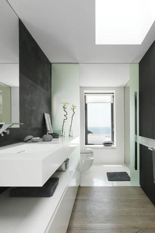 Asian Full Bathroom with Grey coral look soap dispenser round., Wood floors