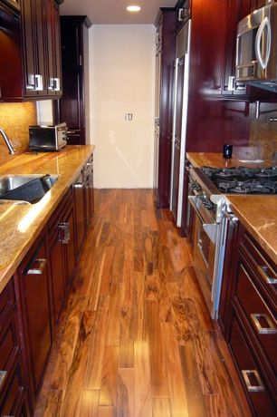 Traditional Kitchen with Marble countertops, can lights, Raised panel, Paint 1, Undermount sink, built-in microwave, Galley