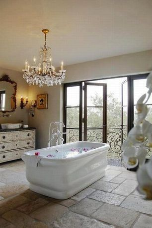 Traditional Master Bathroom with Wall sconce, Slate counters, Chandelier, Master bathroom, Vessel sink, French doors, Balcony