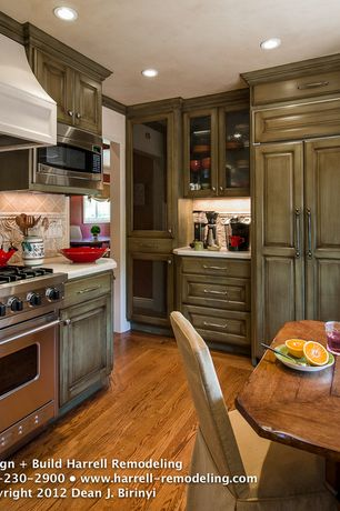 Country Kitchen with Custom hood, Limestone Tile, Breakfast nook, Simple granite counters, Crown molding, Stone Tile