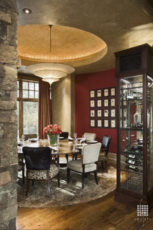 Contemporary Dining Room with Standard height, picture window, flush light, can lights, Hardwood floors, Built-in bookshelf