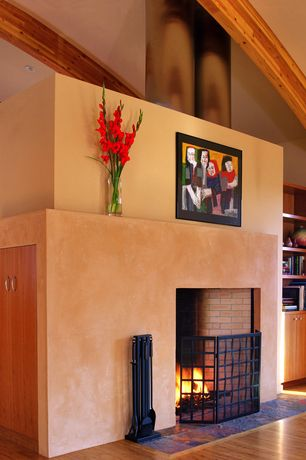 Eclectic Living Room with High ceiling, Fireplace, brick fireplace, Exposed beam, Laminate floors, Built-in bookshelf