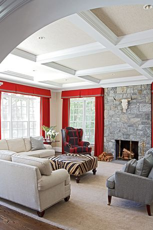 Traditional Living Room with Box ceiling, Hardwood floors, stone fireplace, Crown molding, Exposed beam