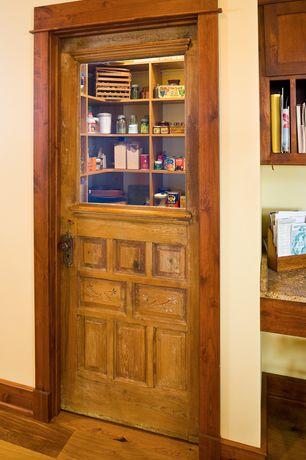 Eclectic Pantry with Built-in bookshelf, Glass panel door, Hardwood floors
