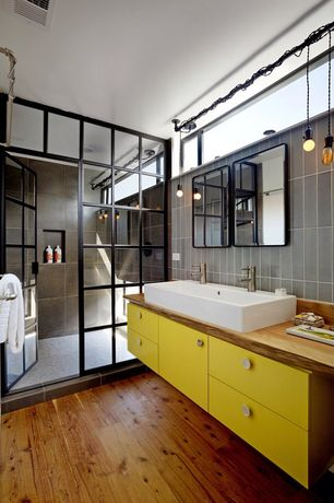 Eclectic 3/4 Bathroom with Shoji door, European Cabinets, Vessel sink, Wood counters, Pendant light, Hardwood floors