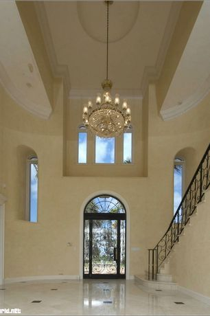 Mediterranean Entryway with Arched window, Transom window, Built-in bookshelf, picture window, Cathedral ceiling, can lights