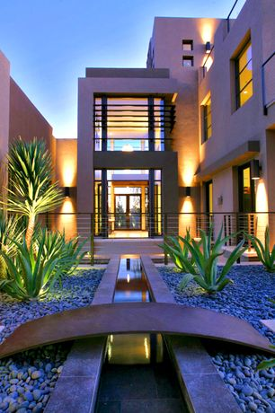 Contemporary Landscape/Yard with Water feature, exterior stone floors, Bridge, Fence, Blackened steel, French doors, Pathway