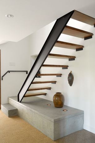 Contemporary Staircase with can lights, Built-in bookshelf, Concrete floors, Metal staircase, Standard height