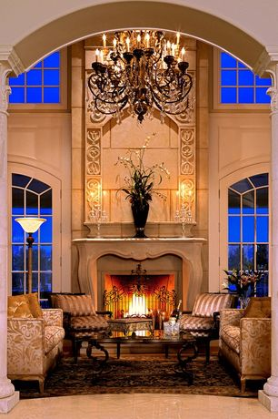 Traditional Living Room with Arched window, Kichler Clayton torchiere lamp, picture window, travertine tile floors, Columns