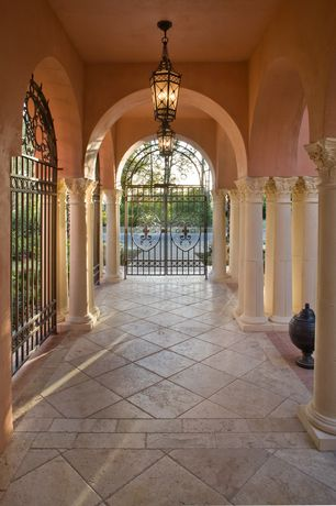 Mediterranean Porch with exterior concrete tile floors, Gate, exterior tile floors
