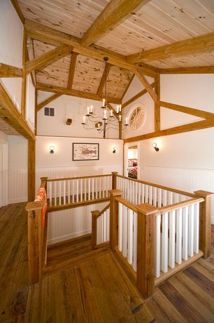 Cottage Staircase with Chandelier, Crown molding, Chair rail, Exposed beam, Hardwood floors, Wall sconce