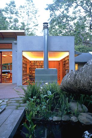 Contemporary Library with exterior stone floors, Transom window, sliding glass door, Paint 1, Indoor/outdoor living