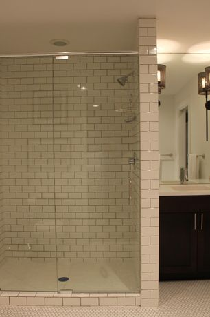 Contemporary 3/4 Bathroom with Corian counters, three quarter bath, penny tile floors, specialty door, Wall Tiles, can lights