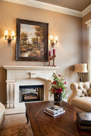 Traditional Living Room with Carpet, Cement fireplace, Fireplace, Wall sconce, specialty window, Crown molding
