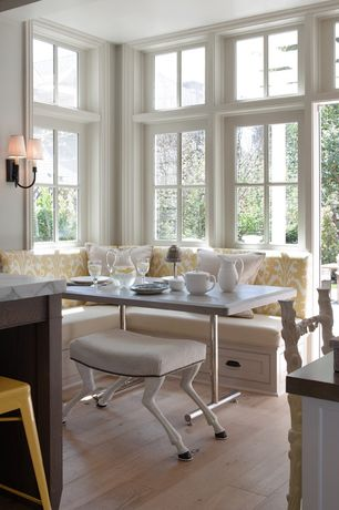Traditional Dining Room with Wall sconce, Tabouret lemon metal counter stools, Transom window, Hardwood floors
