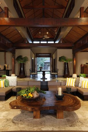 Tropical Great Room with Columns, can lights, travertine floors, Ceiling fan, Sunken living room, picture window, flush light