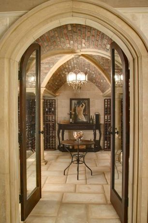 Mediterranean Wine Cellar with Concrete tile , Exposed beam, French doors, Chandelier, Crown molding, Columns, interior brick
