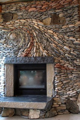 Eclectic Living Room with River rock fireplace