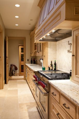 Traditional Kitchen with Undermount sink, double oven range, Stone Tile, specialty door, Standard height, Limestone Tile