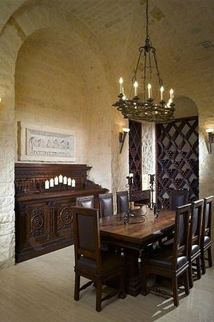 Mediterranean Wine Cellar with High ceiling, Laminate, Bella cera leather arm chair, Medieval small rust brazilian buffet