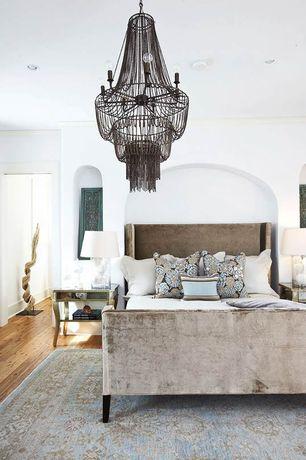 Eclectic Master Bedroom with Chandelier, Hardwood floors, Arteriors home 89414 maxim 22 inch chandelier, Crown molding