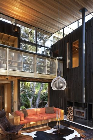 Contemporary Great Room with flush light, French doors, Hardwood floors, Loft, Pendant light, Cathedral ceiling