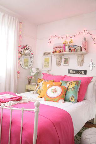 Eclectic Kids Bedroom with Built-in bookshelf, Hardwood floors, no bedroom feature, Paint 1, Standard height
