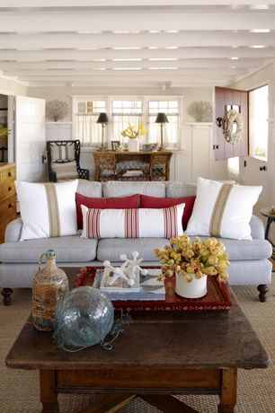 Cottage Living Room with Obx trading group coral table decor, Serena & lily fairfax desk, Hardwood floors, Cafe curtains