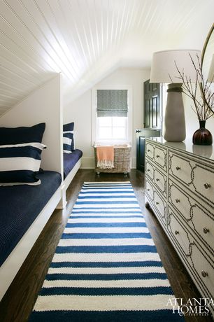 Traditional Guest Bedroom with Casement, Built-in bookshelf, Standard height, Hardwood floors