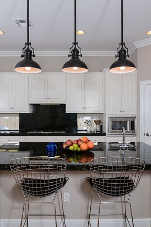 Eclectic Kitchen with Kitchen island, Crown molding, Undermount sink, Knoll bertoia barstool, Inset cabinets, L-shaped