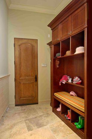 Traditional Mud Room with six panel door, Standard height, travertine tile floors, stone tile floors, Wainscotting