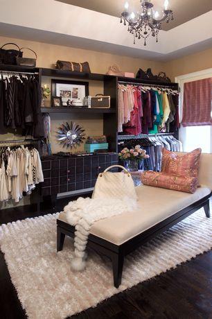 Eclectic Closet with Chandelier, French doors, Hardwood floors, Standard height, Built-in bookshelf