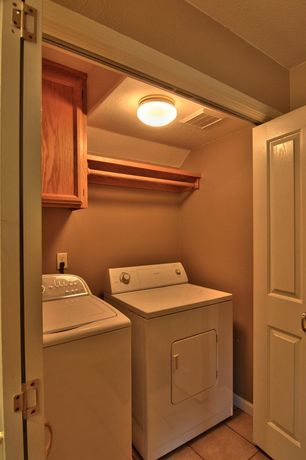 Traditional Laundry Room with stone tile floors, Built-in bookshelf, specialty door, Standard height, Hanging Bar