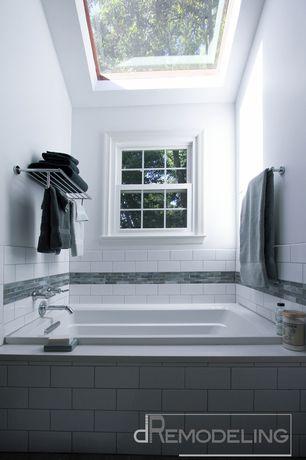 Contemporary Master Bathroom with Master bathroom, Skylight, Standard height, Wall Tiles, drop in bathtub, Bathtub