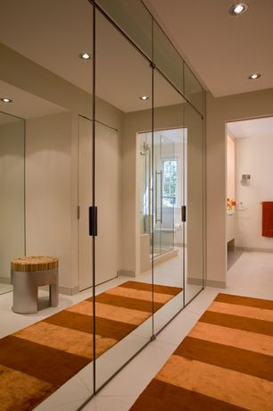 Modern Closet with limestone tile floors