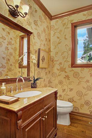 Craftsman Powder Room with wall-mounted above mirror bathroom light, Powder room, Hardwood floors, Limestone counters, Flush