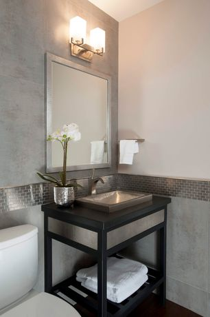 Modern Powder Room with Stainless steel sink, Hardwood floors, Glazed porcelain floor and wall tile, Powder room