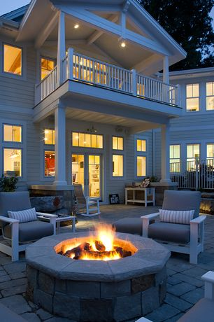 Traditional Patio with French doors, exterior stone floors, Fire pit, Deck Railing, Fossill limestone round fire pit kit