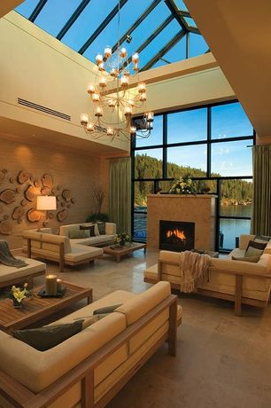 Contemporary Living Room with Tree slice wall art, Exposed beam, Concrete tile , Cathedral ceiling, Chandelier, Skylight