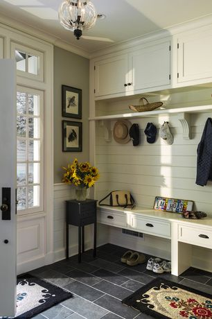 """Traditional Entryway with Built-in bookshelf, 6"""" x 12"""" Black Slate Tile, Shades of Light Fluted Glass Globe Pendant"""
